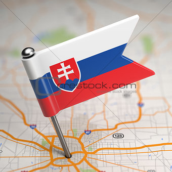 Slovakia Small Flag on a Map Background.