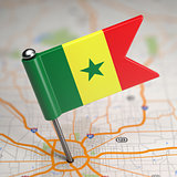 Senegal Flag on a Map Background.