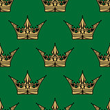 Gold crown on green in a seamless pattern