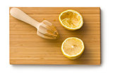 squeezed lemon fruit and citrus reamer