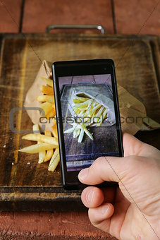 smartphone shot food photo - French fries with salt and ketchup