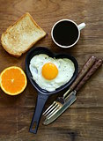 fried egg with fresh orange, toast and coffee for breakfast