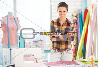 Portrait of happy seamstress in studio