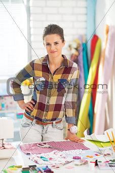 Portrait of seamstress in studio