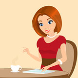 Young pretty woman sitting in the cafe and using a tablet pc.