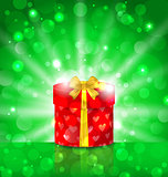 Christmas round gift box on light background with glow