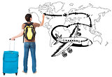young traveler drawing airplane and airline path on the map