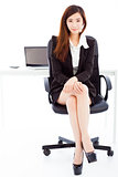 young confident business woman sitting in her office