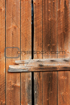 Old wooden weathered barn door