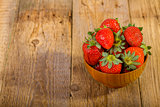fresh strawberries in wood bowl