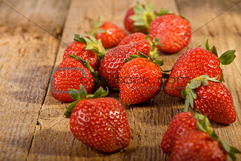 close up of strawberries on wood