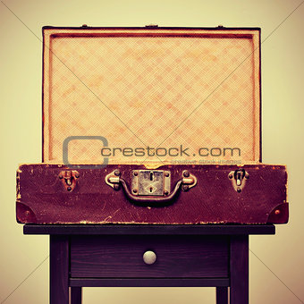 old suitcase on a table, with a retro effect