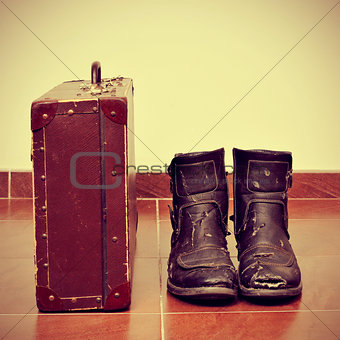 old suitcase and worn boots