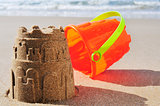 toy bucket sandcastle on the sand of a beach