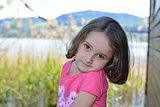 Little girl posing on a lake