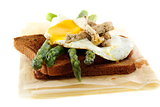 Rye bread with asparagus, eggs and turkey.