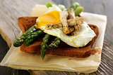 Toast with green asparagus and egg.