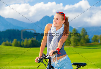 Cyclist girl in mountains