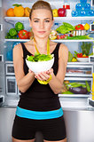 Healthy woman with fresh salad