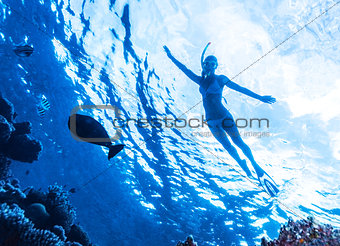 Active woman diving