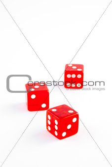 three red dice on white background