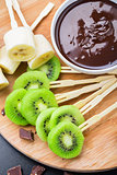 Fruits with chocolate on a stick