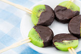 Kiwi with chocolate on a stick