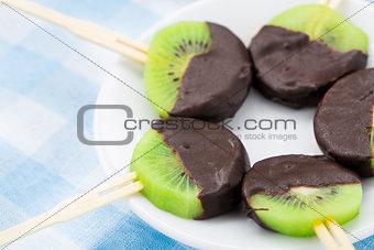 Kiwi with chocolate on a stick