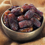 Dates fruit in metal bowl.