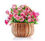 Bunch pink roses in wicker basket