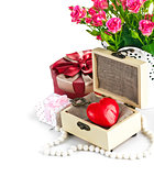 Red heart wooden casket with bunch roses