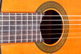 fingerboard and sound hole of acoustic guitar
