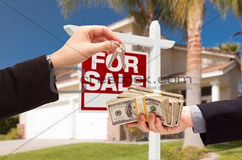 Agent Handing Over Keys, Buyer Handing Over Cash for House