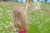 girl in wild daisy field