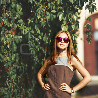 Beautiful teenage girl in sunglasses.