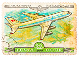 Stamp printed in USSR shows the Aeroflot Emblem and aircraft wit