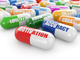 Skills concept. Pills with a list of positive qualities for empl