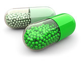 Green pills and drugs on white isolated background. Medical conc