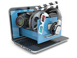 Multimedia concept. Laptop, camera , headphones and video attrib