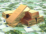 Gold ingots on background from euro banknotes.