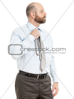 business man selects tie