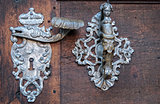 Door-handle decoration detail of old  entrance door in Prague