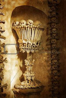 Skulls and bones. Kutna Hora, Czech Republic. textured old paper