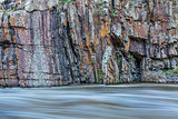 rock cliff and whitewater river