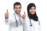 Arab saudi emirates doctors happy with thums up
