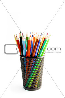 colored pencils in a container on white background