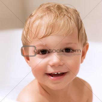 Sweet little boy bathing