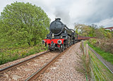 Steam train traveling through countryside