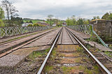 View down railway track in english countryside