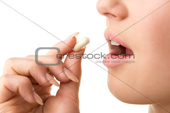 closeup taking pill